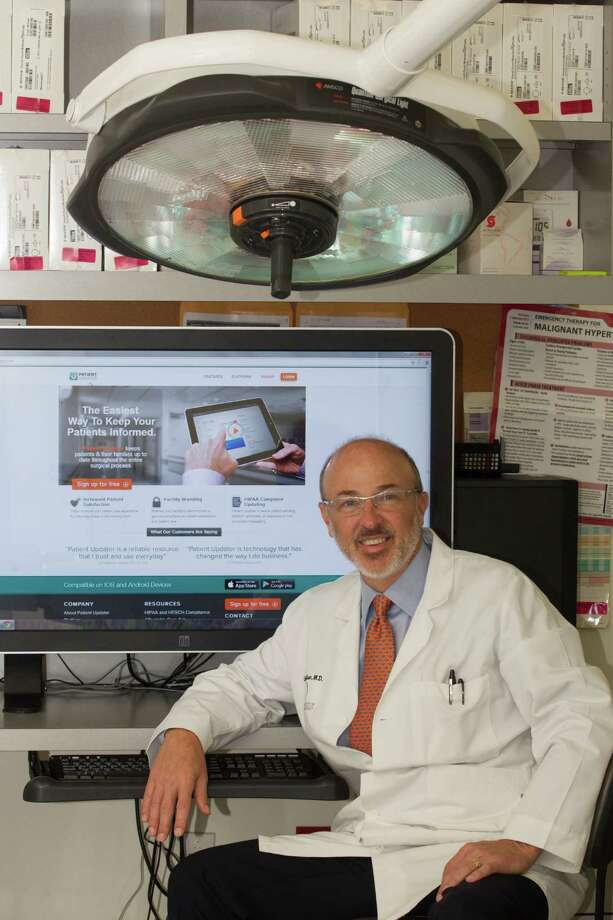 Dr. Clayton Moliver, a Clear Lake plastic surgeon, is one of the co-founders of Patient Updater. The Web-based app allows doctors to text families to keep them updated on the surgery process. Photo: J. Patric Schneider, Freelance / © 2013 Houston Chronicle