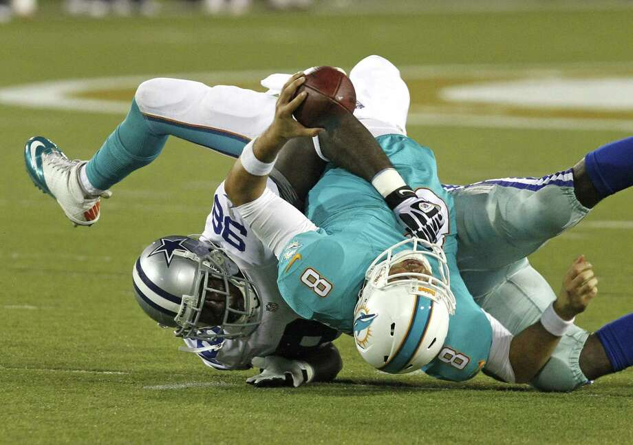 With injuries opening the door, Cowboys defensive end George Selvie made his presence felt on Sunday, something to which Dolphins QB Matt Moore can attest. Photo: Rodger Mallison, MBR / Fort Worth Star-Telegram