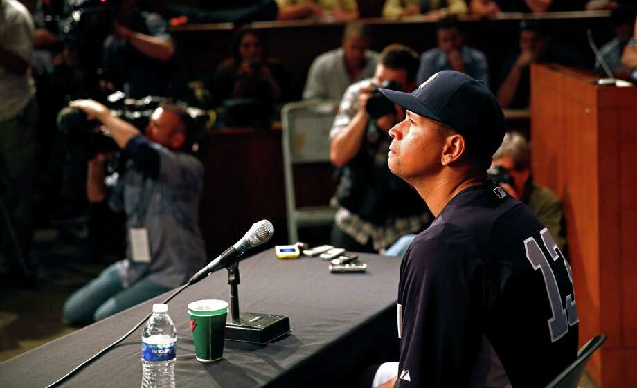 New York Yankees' Alex Rodriguez has a news conference before the Yankees play the Chicago White Sox in a baseball game at US Cellular Field in Chicago on Monday, Aug. 5, 2013. Rodriguez was suspended through 2014 and All-Stars Nelson Cruz, Jhonny Peralta and Everth Cabrera were banned 50 games apiece Monday when Major League Baseball disciplined 13 players in a drug case, the most sweeping punishment since the Black Sox scandal nearly a century ago. (AP Photo/Charles Cherney) ORG XMIT: CXC110 Photo: Charles Cherney / FR170067 AP