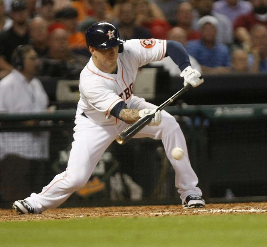 August 5: Astros 2, Red Sox 0Astros center fielder Brandon Barnes lays down a bunt to assist left fielder L.J. Hoes to score the second run against the Red Sox. Photo: Johnny Hanson, Houston Chronicle