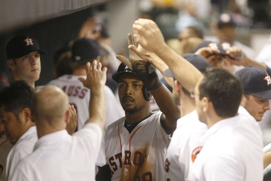 Astros left fielder L.J. Hoes is congratulated in the dugout after scoring a run against the Red Sox. Photo: Johnny Hanson, Houston Chronicle