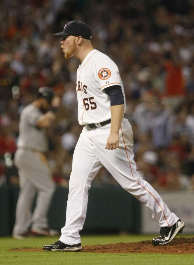 Astros relief pitcher Brett Oberholtzer reacts after striking out Red Sox shortstop Stephen Drew in the seventh inning Photo: Johnny Hanson, Houston Chronicle