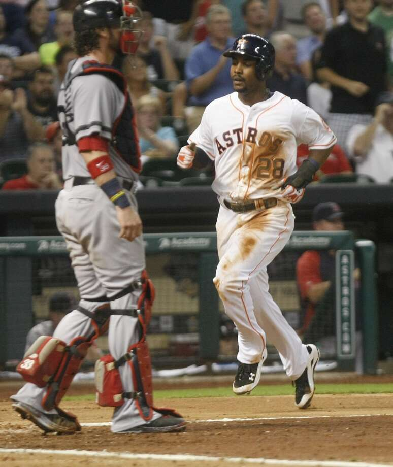 Astros left fielder L.J. Hoes scores the first run in the fifth inning against the Red Sox. Photo: Johnny Hanson, Houston Chronicle