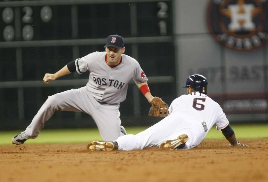 Astros shortstop Jonathan Villar safely slides into second base against the Red Sox. Photo: Johnny Hanson, Houston Chronicle