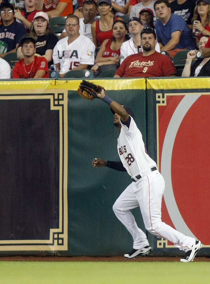 Astros left fielder L.J. Hoes catches a flyable hit by Red Sox first baseman Mike Napoli in the fourth inning. Photo: Johnny Hanson, Houston Chronicle