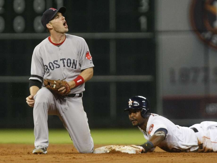 Astros left fielder L.J. Hoes slides safely into second base past the tag of Red Sox shortstop Stephen Drew in the fifth inning Photo: Johnny Hanson, Houston Chronicle