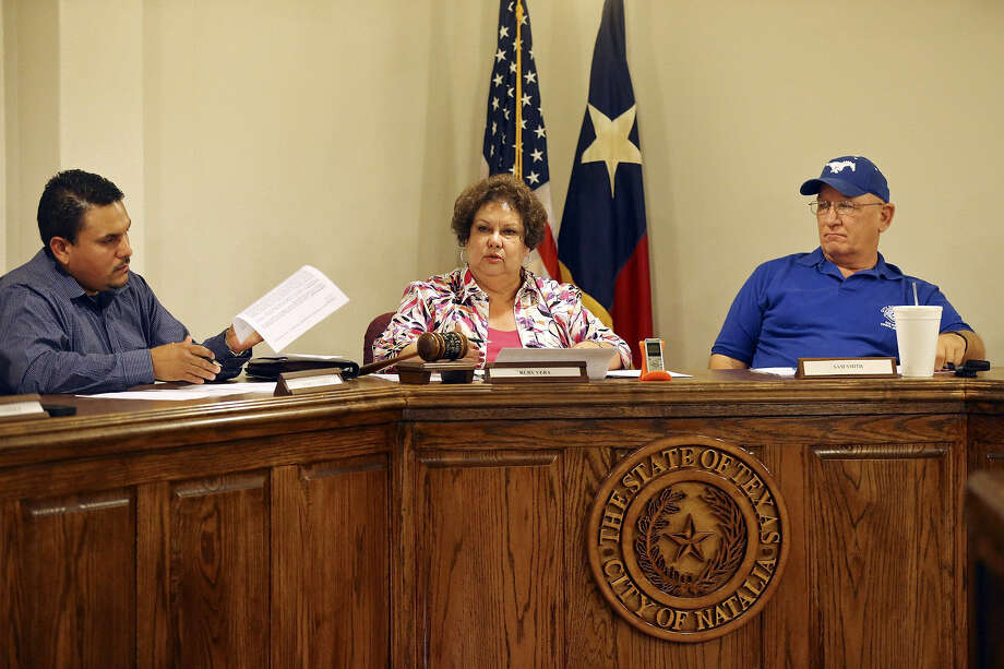 Natalia Mayor Ruby Vera (center) says police department downsizing included one secretary and three officers paid with funds from the city's impound lot. Photo: Edward A. Ornelas / San Antonio Express-News