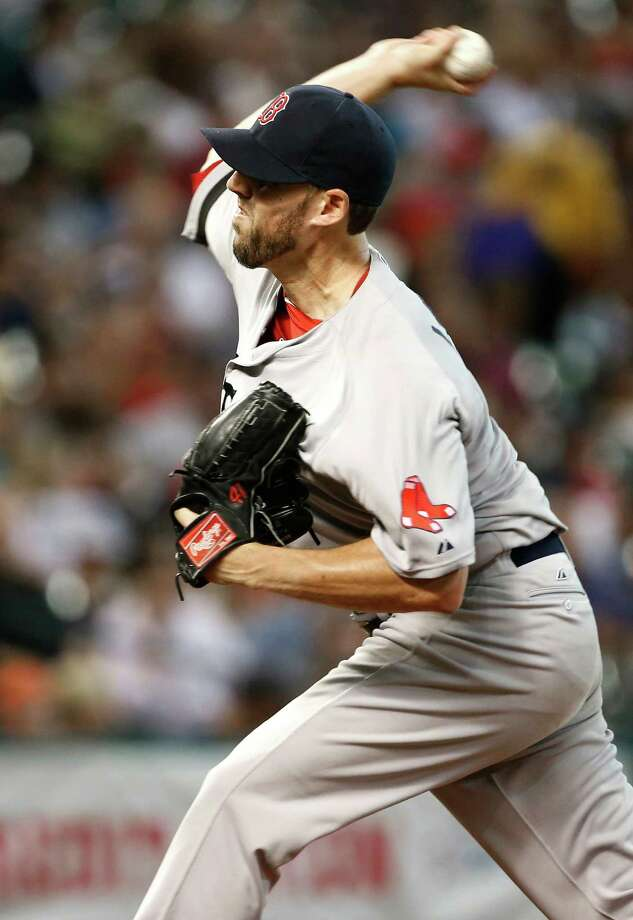 Boston Red Sox's John Lackey delivers a pitch against the Houston Astros in the third inning of a baseball game, Monday, Aug. 5, 2013, in Houston. (AP Photo/Pat Sullivan) ORG XMIT: HTA107 Photo: Pat Sullivan / AP