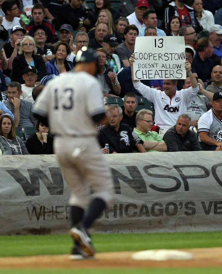 A fan has a message for Alex Rodriguez (13) during Monday night's Yankees-White Sox game at U.S. Cellular Field in Chicago. Photo: Scott Strazzante, STR / Chicago Tribune