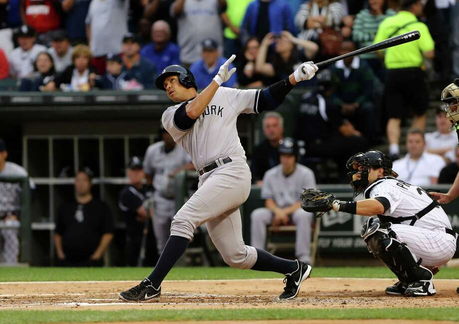 The Yankees' Alex Rodriguez singles in his first at-bat in the first inning against the White Sox at Chicago. Photo: Charles Cherney, FRE / FR170067 AP