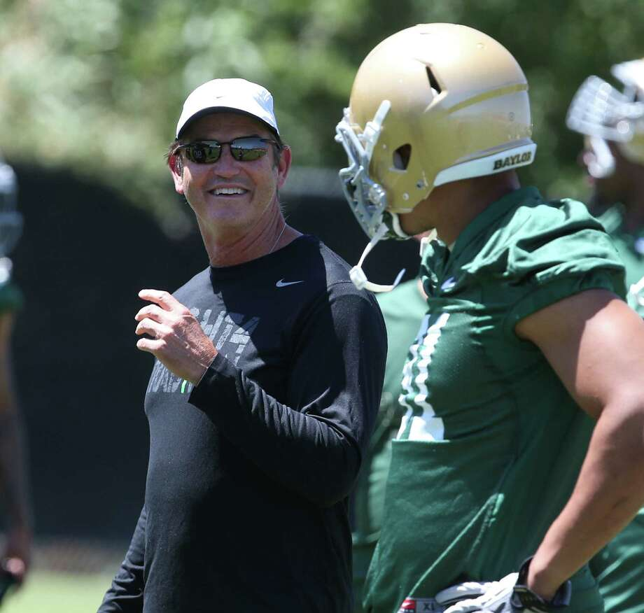 Coach Art Briles (left) has changed Baylor's perception as a perennial doormat to a team that has three consecutive bowl trips and boasts 2011 Heisman Trophy winner Robert Griffin III. Photo: Rod Adeylotte / Waco Tribune Herald