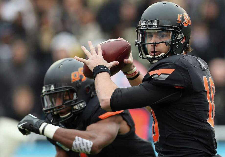 Quarterback Clint Chelf and 14th-ranked Oklahoma State will visit UTSA in the Alamodome on Sept. 7. Photo: Ronald Martinez / Getty Images