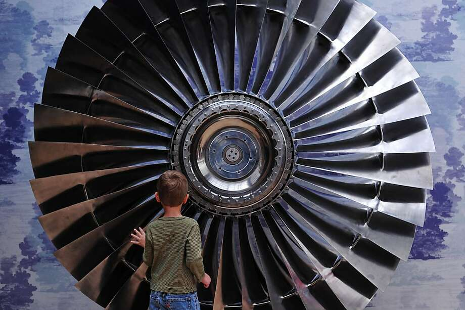 Elia Lemanski, 4 , poses for photographers next to a 1970 Stage One  Rolls Royce RB211 Titanium Turbine Fan at Christies auction house in central London on August 5, 2013.  Forming part of the 'Out of the Ordinary' sale on September 5, 2013 it is expected to fetch between GBP 60,000-80,000  (USD 91,965 - 122,637, Euros 69,456 - 92,610).  TOPSHOTS/AFP PHOTO / CARL COURTCARL COURT/AFP/Getty Images Photo: Carl Court, AFP/Getty Images