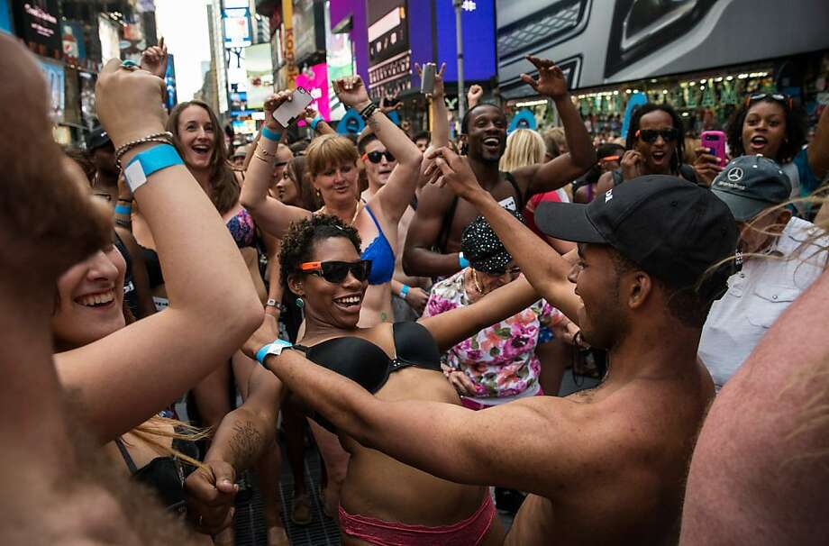 "NEW YORK, NY - AUGUST 05:  Revelers wearing only their underwear dance in Times Square in an attempt to break a Guinness Book of World Records' record for ""the most amount of people gathered in their underwear in the Times Square section of New York"" on August 5, 2013 in New York City. Organizers were hoping to get 2,271 people to strip down to their underwear - the current record is 2,270.  (Photo by Andrew Burton/Getty Images) Photo: Andrew Burton, Getty Images"