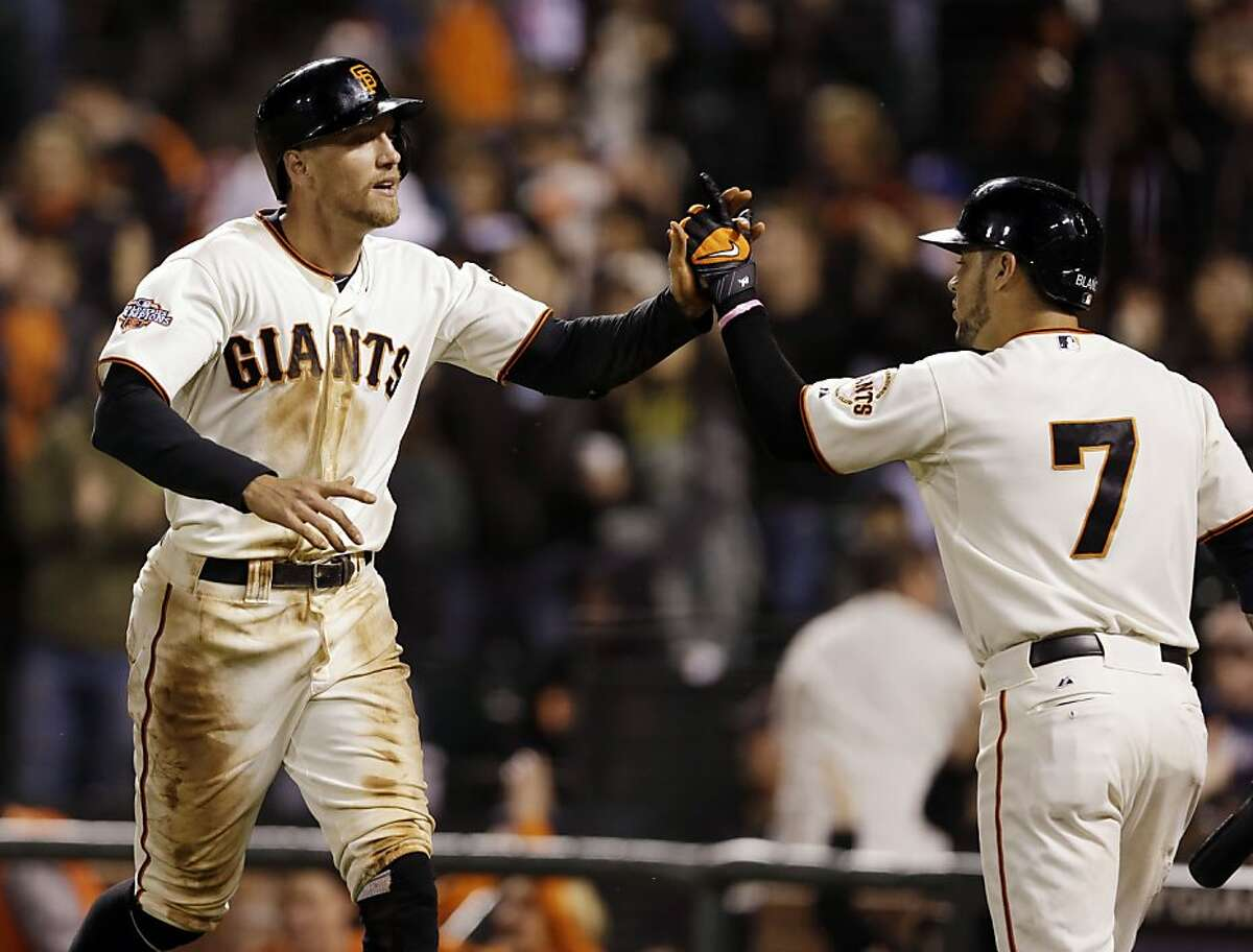 San Francisco Giants' Hunter Pence celebrates with Gregor Blanco (7) after Pence scored on a single by Jeff Francoeur during the eighth inning of a baseball game on Monday, Aug. 5, 2013, in San Francisco. (AP Photo/Marcio Jose Sanchez)