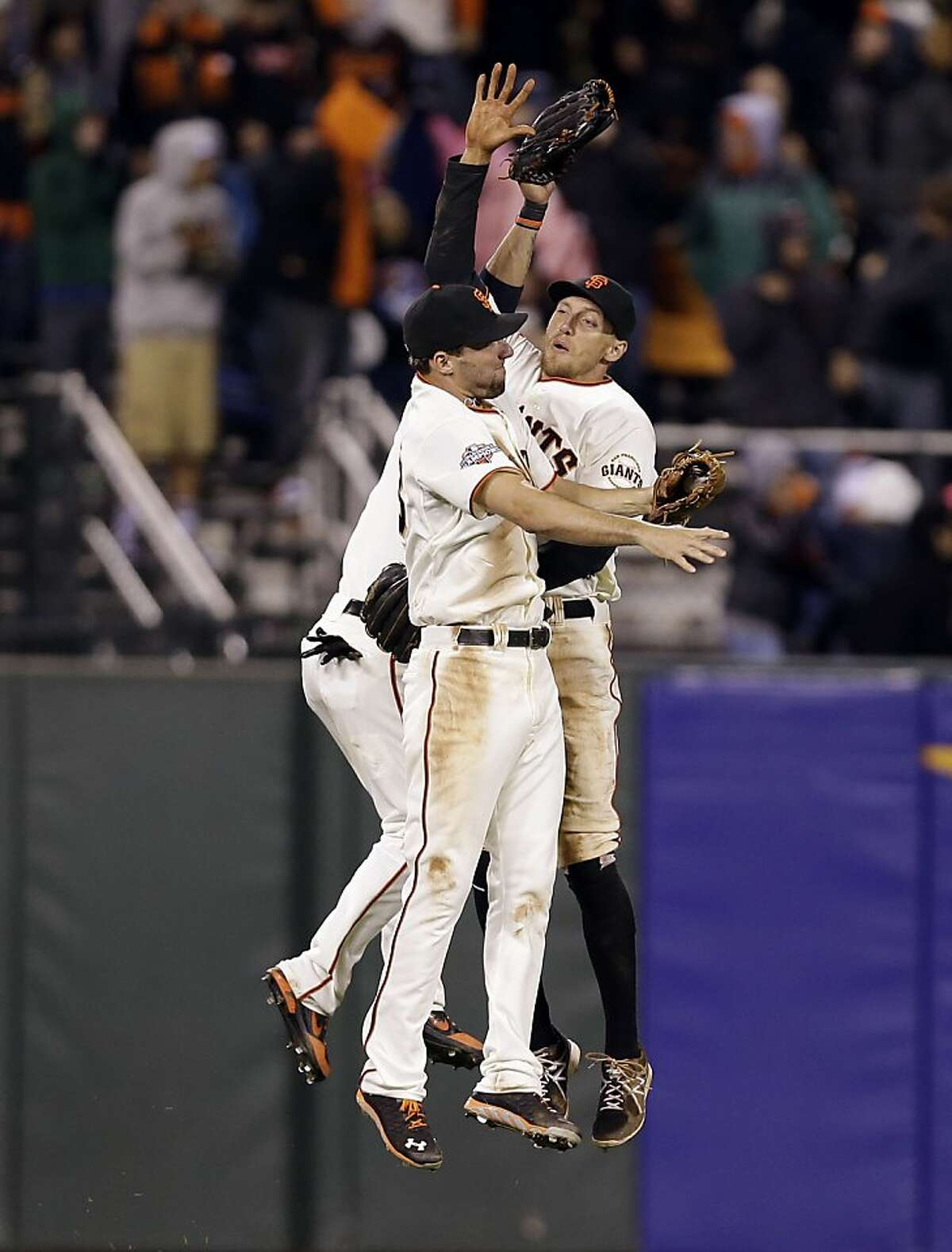 San Francisco Giants' Jeff Francoeur, left, and Hunter Pence celebrate a 4-2 win over the Milwaukee Brewers during a baseball game on Monday, Aug. 5, 2013, in San Francisco. (AP Photo/Marcio Jose Sanchez)