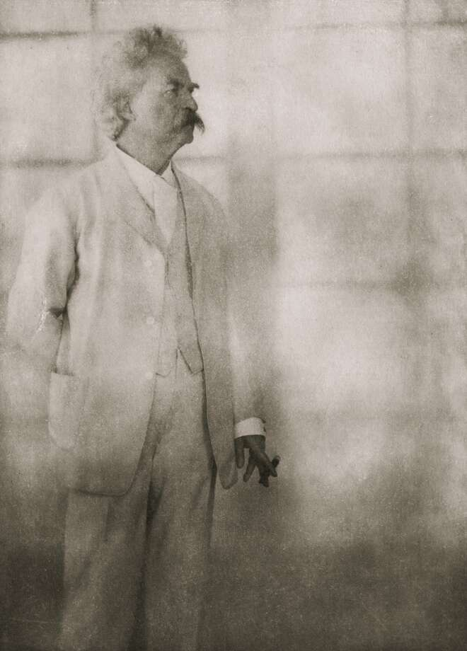 American writer and humorist Mark Twain (1835 - 1910) at Stormfield, his home in Redding, Connecticut, 21st December 1908. Photo: Alvin Langdon Coburn, Getty Images