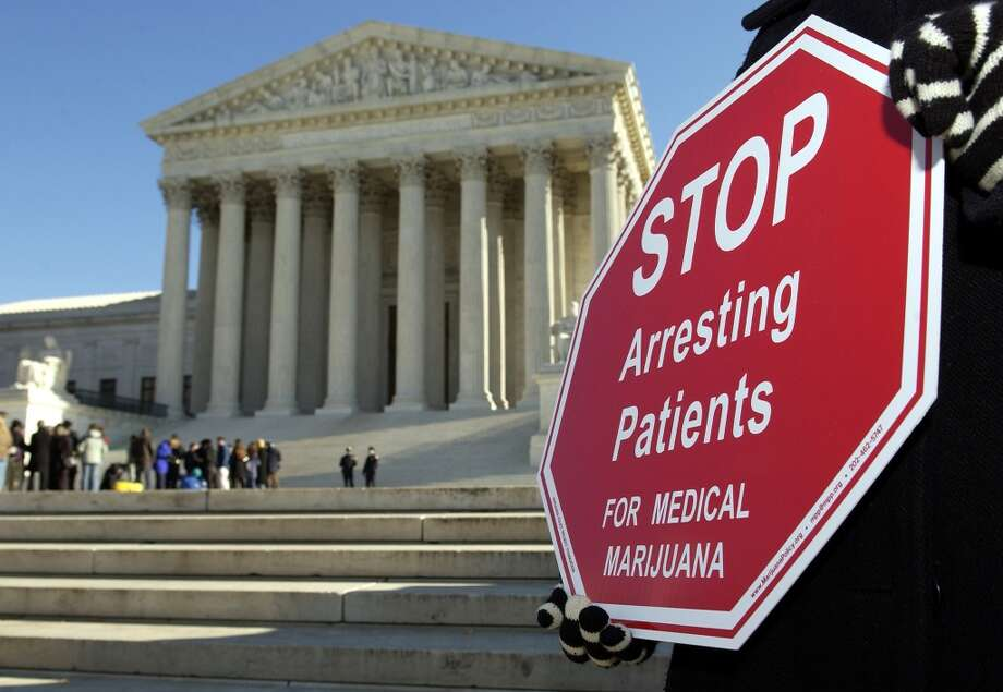 District of Columbia did it with the ''Legalization of Marijuana for Medical Treatment Amendment Act of 2010.'' It was approved 13-0 by the Council of the District of Columbia on May 4, 2010; signed by the Mayor on May 21, 2010, according to procon.org, a nonprofit organization tracking marijuana laws and other controversial issues in America. D.C.'s council has also decriminalized possession. Photo: Mannie Garcia, Getty Images