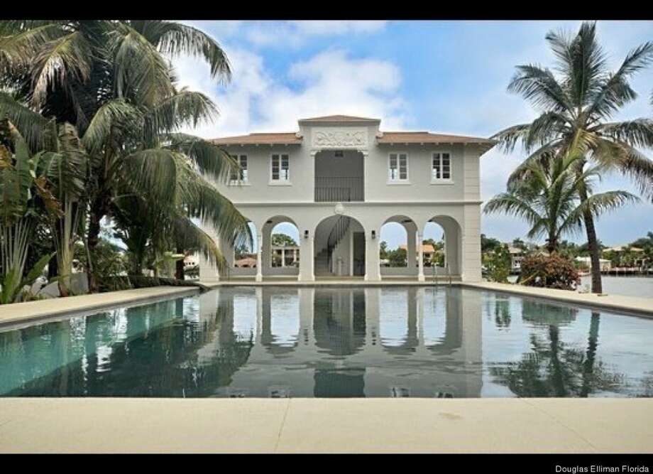 Pool house, long shot. Photos via Douglas Elliman Florida.