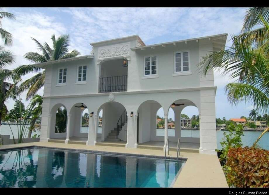 Closer view of pool house- 2 bedrooms in there! Douglas Elliman Florida