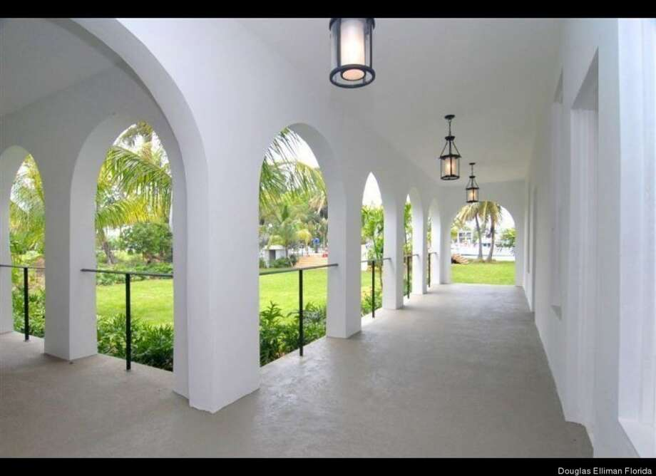 Long Mediterranean hall.  Doorways where no one can hide, just in case you're a mafia don. Douglas Elliman Florida