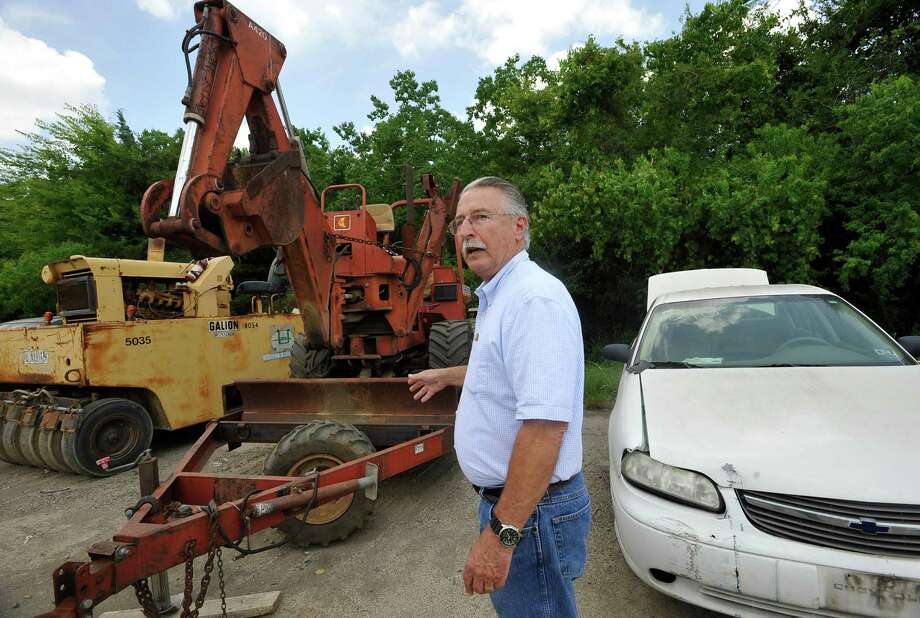 The City of Beaumont sells old outdated, past it's prime, can't get parts for, and wrecked items including heavy equipment through an online auction service. They have another one coming up that will run from August 8-August 22 that will have 40 plus items. It helps them defray the cost of new equipment and operations.  An outdated back hoe sits alongside a car as Fleet Superintendent Jeff Chavez talks about how many back hoes he has been able to sell in the past.  Dave Ryan/The Enterprise Photo: Dave Ryan