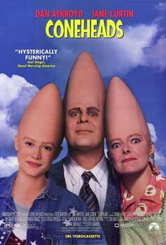 """Coneheads"" - With enormous cone-shaped heads, robotlike walks and an appetite for toilet paper, aliens Beldar and Prymatt don't exactly blend in with the population of Paramus, N.J. But for some reason, everyone believes them when they say they're from France.  Now Available"