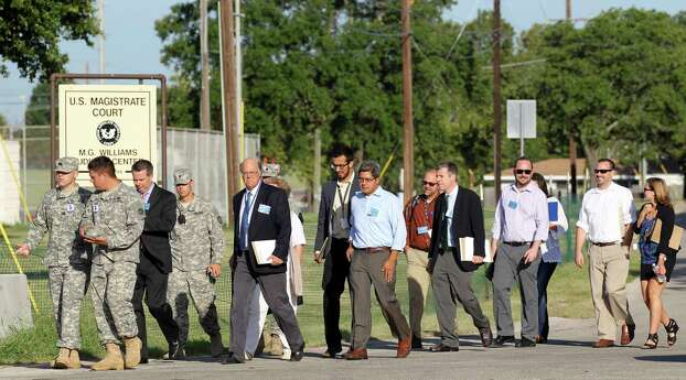 Selected through a lottery, media members head to the M.G. Williams Judicial Center for the first day of the capital murder trial of U.S. Army Lt. Nidal Malik Hasan at Fort Hood, Tuesday, August 6, 2013. Hasan is facing 13 counts of premeditated murder and 32 counts of attempted premeditated murder in the shooting rampage at Fort Hood on Nov. 5, 2009. Photo: San Antonio Express-News / ©2013 San Antonio Express-News