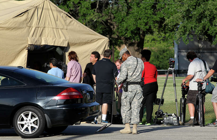 Media members and vehicular traffic go through security at the heavily fortified M.G. Williams Judicial Center on the first day of the capital murder trial of U.S. Army Lt. Nidal Malik Hasan at Fort Hood, Tuesday, August 6, 2013. Hasan is facing 13 counts of premeditated murder and 32 counts of attempted premeditated murder in the shooting rampage at Fort Hood on Nov. 5, 2009. Photo: San Antonio Express-News / ©2013 San Antonio Express-News