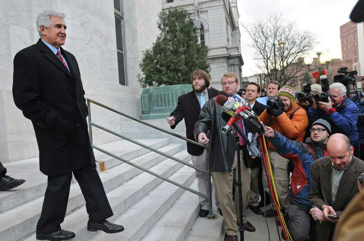 Joe Bruno walks out into a mass of media Dec.1, 2009, outside the James T. Foley U.S. Courthouse in Albany, N.Y. (Lori Van Buren / Times Union archive)