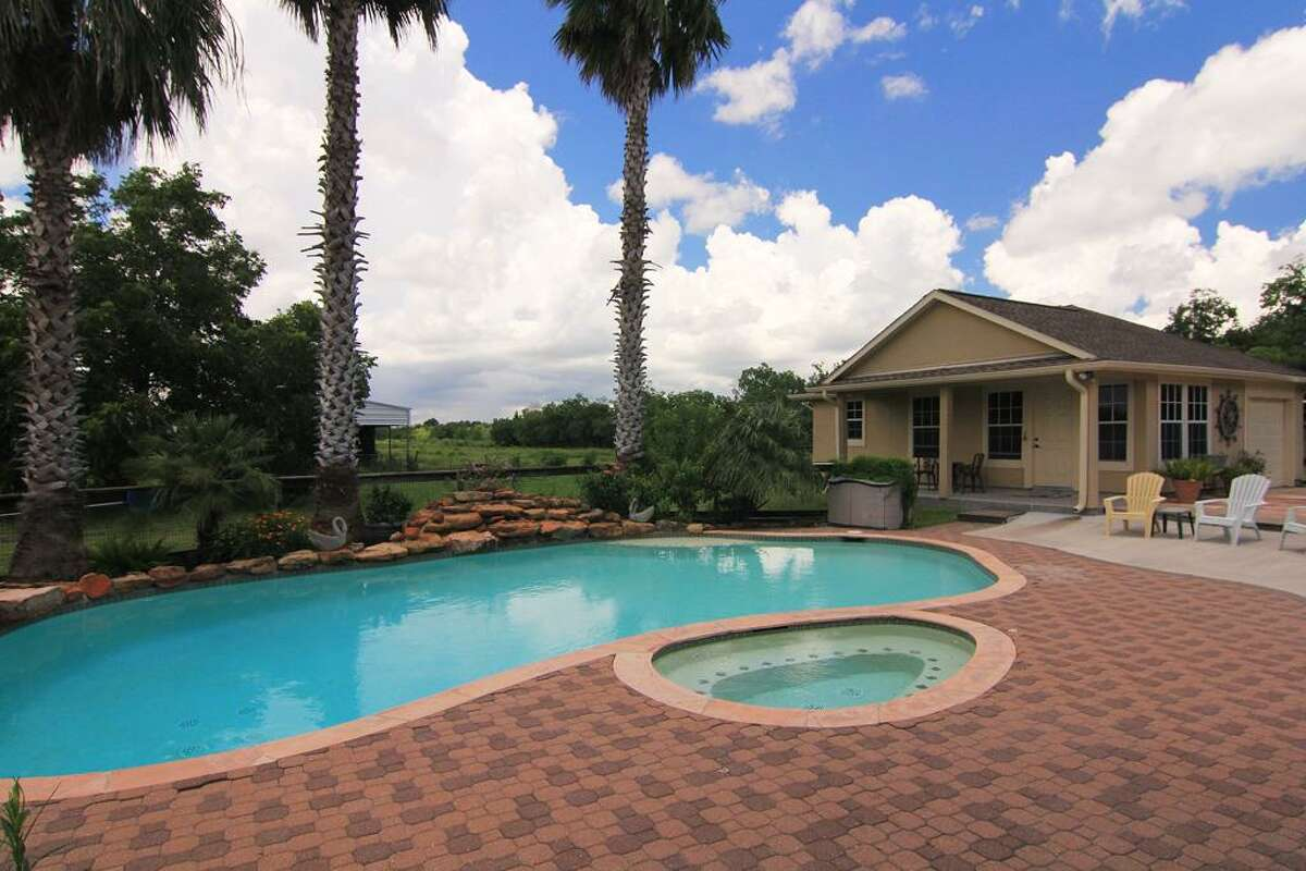The property features a pool and hot tub.