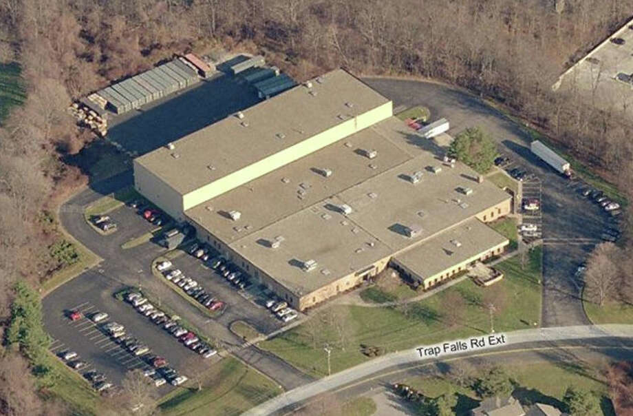Cambridge Hanover, a privately held real estate investment firm based in New Canaan, has bought 100 Trap Falls Road Extension, an 81,500-square-foot office, production and warehouse facility that formerly housed W.E. Bassett operations, for $3.32 million or $41 per square foot. Photo: Contributed