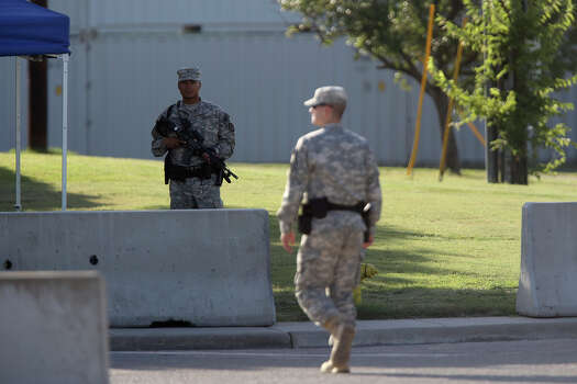 A soldier stands guard outside the Lawrence H. Williams Judicial Center as the trial for Maj. Nidal Hasan begins at Fort Hood in Killeen on Tuesday, August 6, 2013. Photo: Lisa Krantz, San Antonio Express-News / San Antonio Express-News