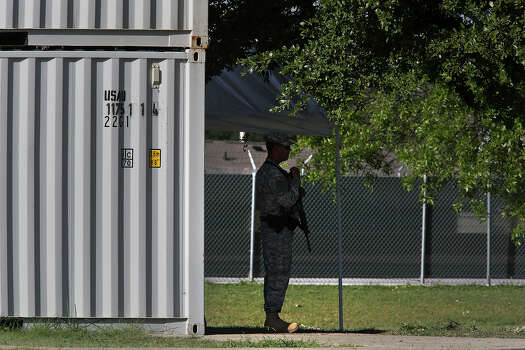 A soldier stands guard near the Lawrence H. Williams Judicial Center as the trial for Maj. Nidal Hasan begins at Fort Hood in Killeen on Tuesday, August 6, 2013. Photo: Lisa Krantz, San Antonio Express-News / San Antonio Express-News