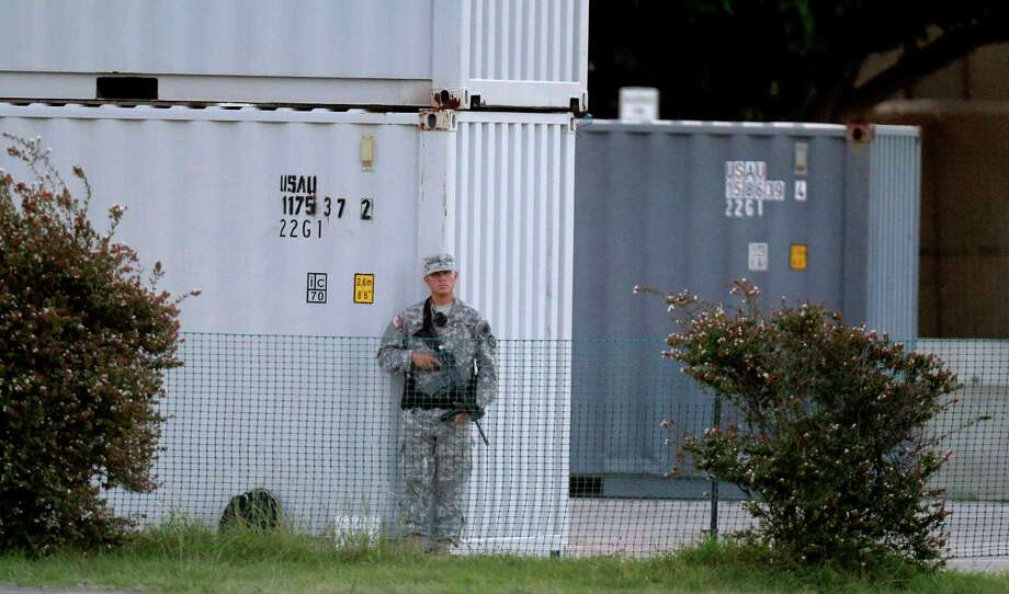 A U.S. solider stands guard outside where the court-martial of Maj. Nidal Malik Hasan is beginning, Tuesday, Aug. 6, 2013, in Forth Hood, Texas. After years of delays, the trial of the man who carried out the Fort Hood shooting is starting, with Hasan representing himself against charges of murder and attempted murder for the 2009 attack that left 13 people dead on the Army post. (AP Photo/LM Otero) Photo: LM Otero, STF / AP