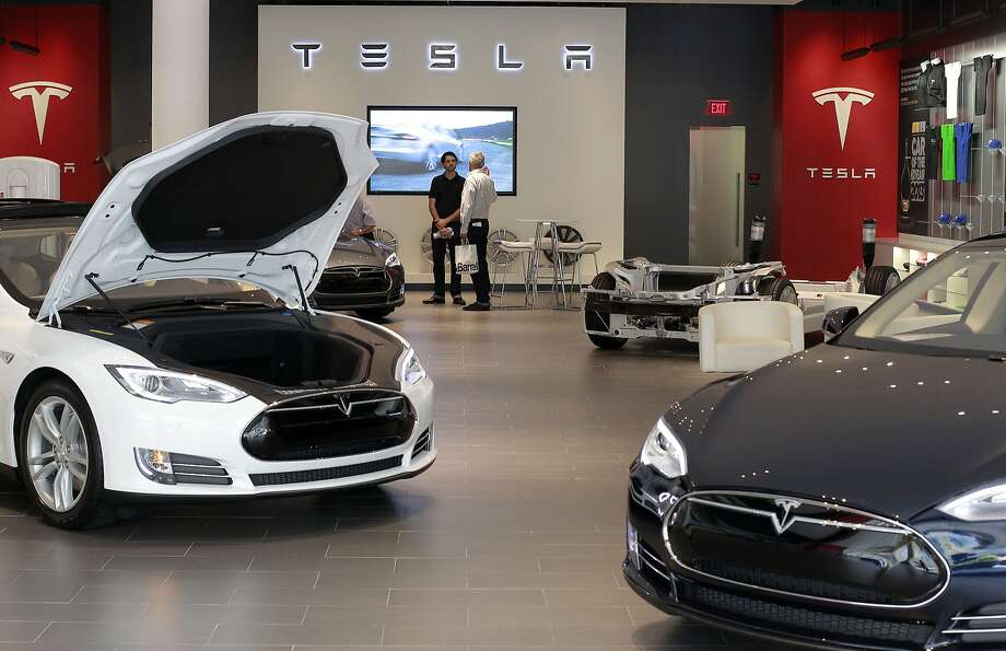 "The Tesla showroom in the Santana Row shopping center in San Jose, Calif. on Tuesday July 30, 2013. Tesla sells directly to customers, rather than working through franchise auto dealers. Existing dealers consider that a threat. So in state after state (except California), the dealers have tried to shut out Tesla by asking legislators to tweak existing laws  that protect franchises. Tesla runs a network of ""stores"" rather than dealerships. Photo: Michael Macor, San Francisco Chronicle"
