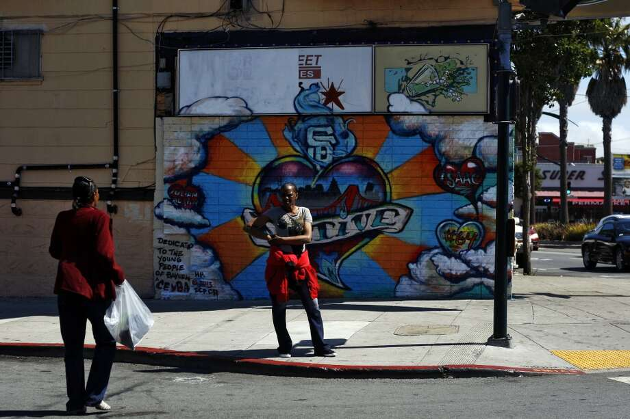 A woman (who preferred not to be named) stands on the corner of Newcomb and 3rd street in Bayview, a neighbourhood that is going through a number of changes at the moment on Friday, July 26, 2013 in San Francisco, Calif. Photo: The Chronicle
