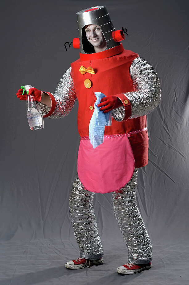 Catriona Taylor performing as 'Robbie the Robot' poses stating if she was not at the Edinburgh Fringe Festival she would be being a dental student on August 6, 2013 in Edinburgh, Scotland. The city is in full swing with hundreds of entertainers attending the Edinburgh Fringe Festival which runs from the 2 -26 August and is one of the largest arts festivals in the world, dating back to 1947. Photo: Jeff J Mitchell, Getty Images / 2013 Getty Images