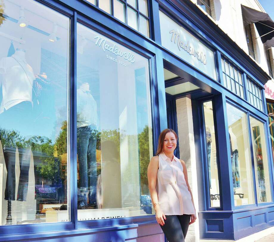 Meg Caro, manager of the new Madewell women's clothing and accessories store, in front of the shop at 155 Main St. Photo: Todd Tracy / Westport News contributed