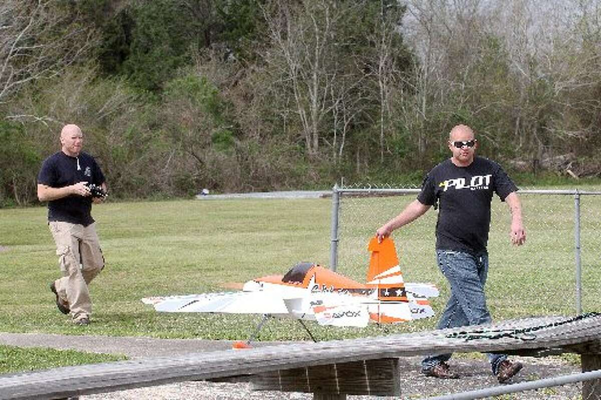 """Justin Wallace, left, and Scott Edge roll out a """"Big Bird"""" for flying at the Alvin Radio Control Club field. Justin Wallace, left, and Scott Edge roll out a """"Big Bird"""" for flying at the Alvin Radio Control Club field."""