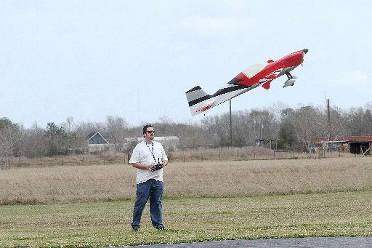 Marty Robinson flies his plane at the club's field in Alvin. Marty Robinson flies his plane at the club's field in Alvin.