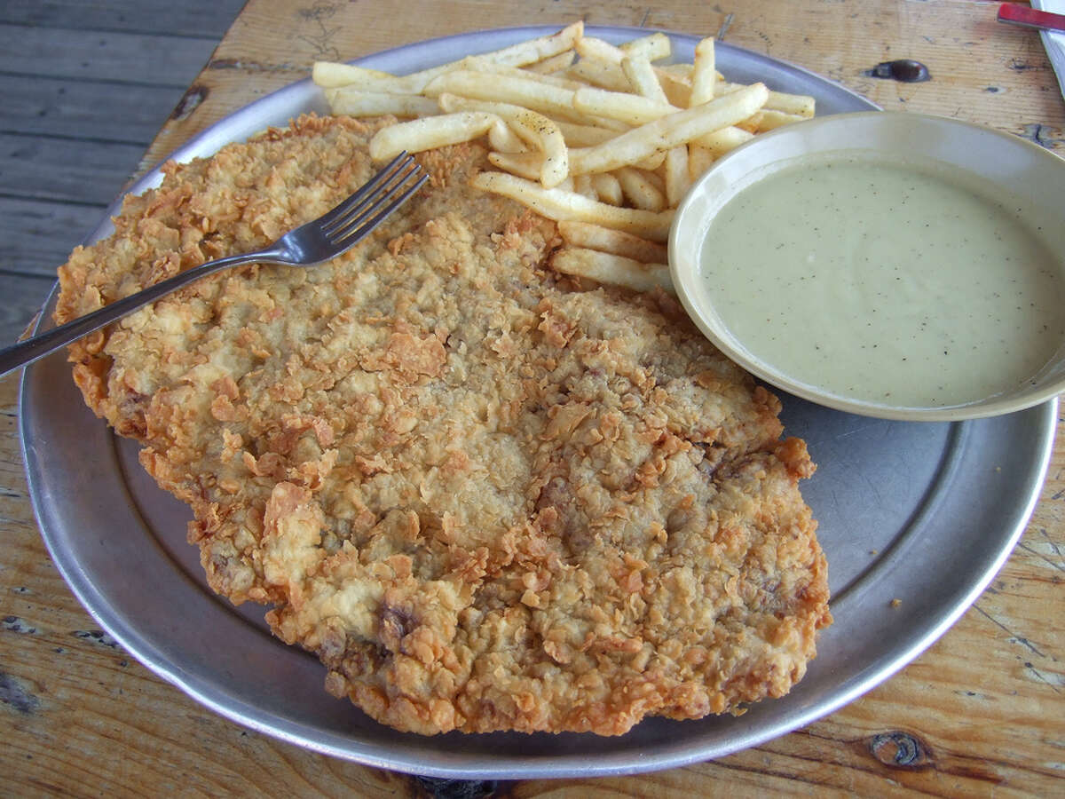 One of Hickory Hollow's famous chicken-fried steaks is shown with fries and gravy.