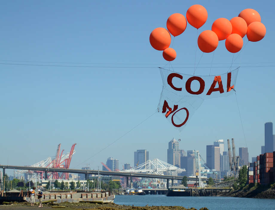"A banner that reads ""Coal, No"" flies over the Duwamish. Photo: SY BEAN, SEATTLEPI.COM / SEATTLEPI.COM"