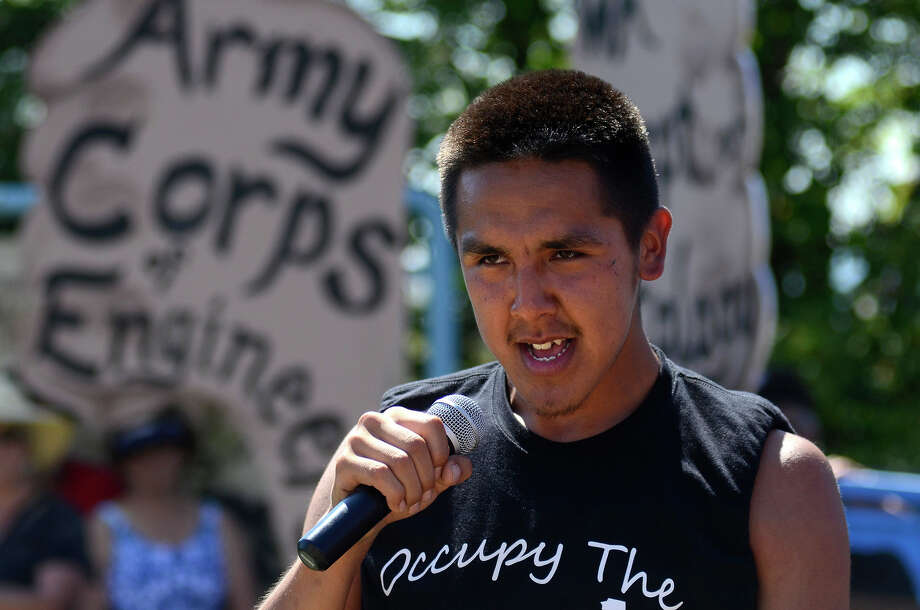 A youth member of Alaskan First, an organization from Alaska, speaks to the crowd before marching in front of the US Army Corps of Engineers' offices.  Photo: SY BEAN, SEATTLEPI.COM / SEATTLEPI.COM