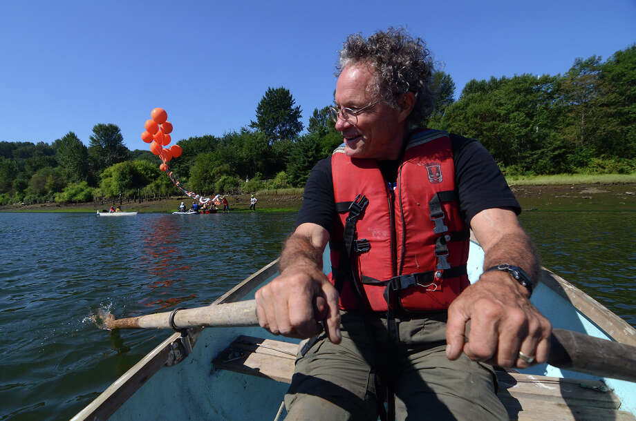 Evan Simmons, a supporter of the Backbone Campaign, paddles towards the large banner that will fly over the Duwamish. Photo: SY BEAN, SEATTLEPI.COM / SEATTLEPI.COM