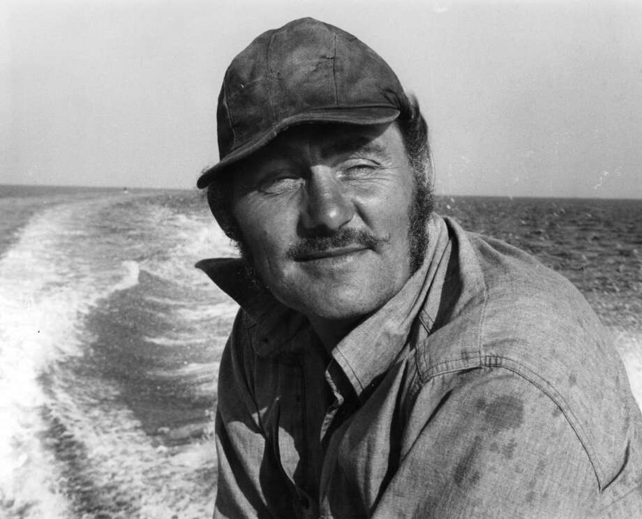 Robert Shaw stands around netting in a scene from the film 'Jaws', 1975. Photo: Getty Images