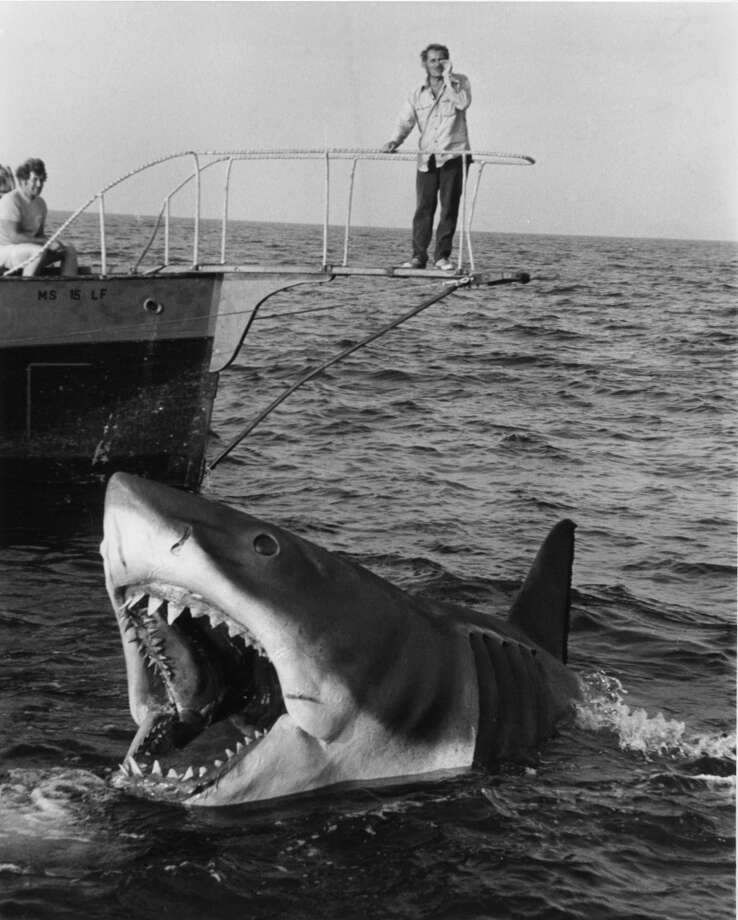 Robert Shaw stands over Jaws in a scene from the film 'Jaws', 1975. Photo: Getty Images