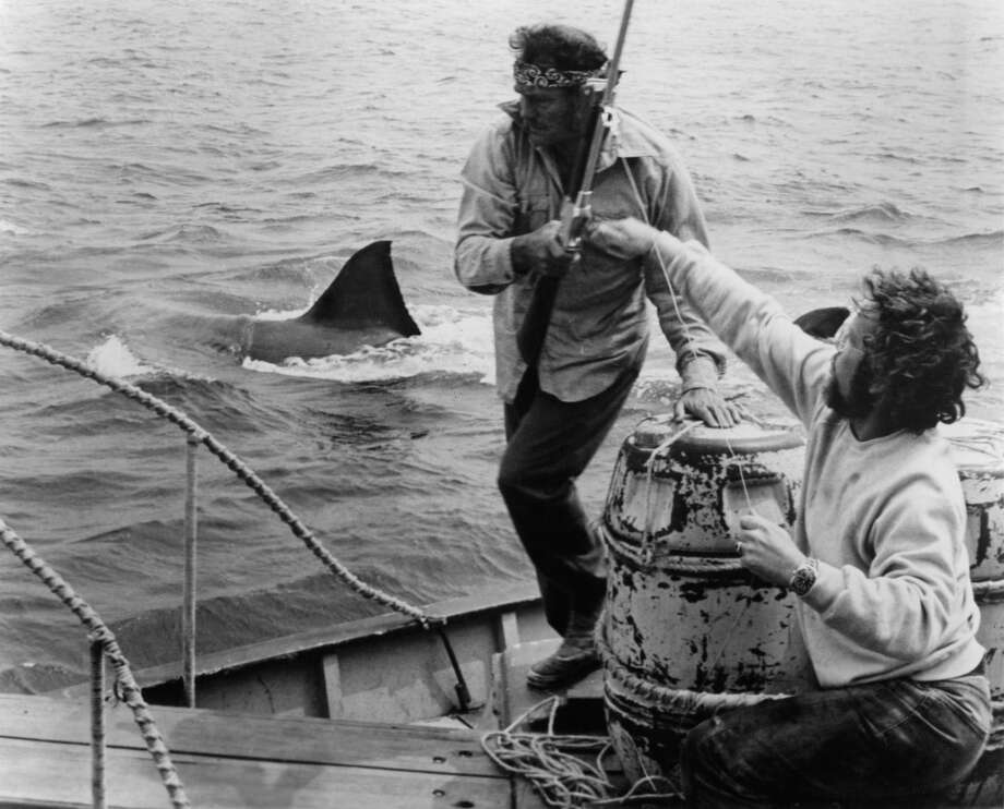 Robert Shaw and Richard Dreyfuss prepare to do battle with a mammoth   man eating Great White Shark in a scene from the film 'Jaws', 1975. Photo: Getty Images