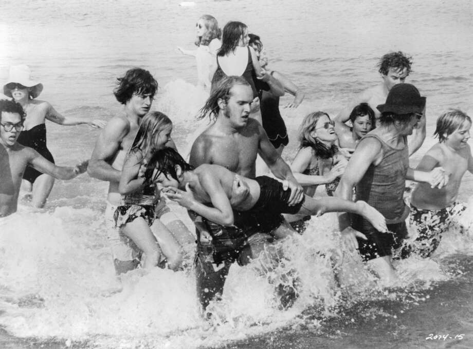 A group of unknown actors are running out of the ocean in a panic in a scene from the film 'Jaws', 1975. Photo: Getty Images