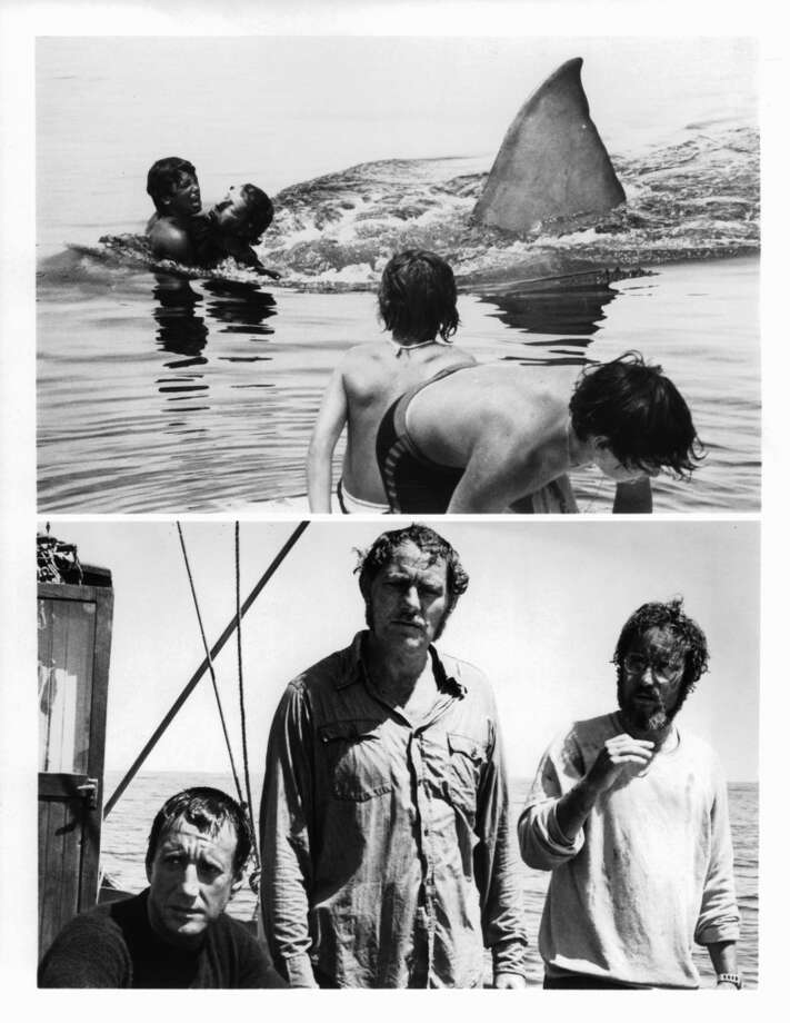 Great White Shark attacks swimmers (above), Roy Scheider, Robert Shaw, and Richard Dreyfuss on boat in serious contemplation in a scene from the film 'Jaws', 1975. Photo: Getty Images